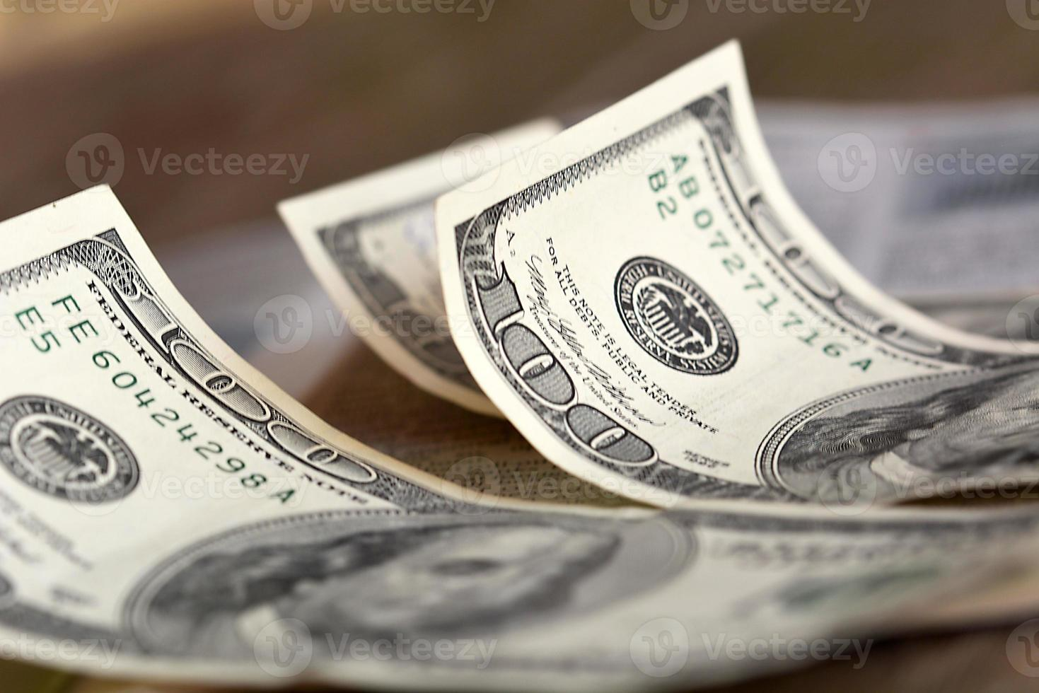 notas de cem dólares foto