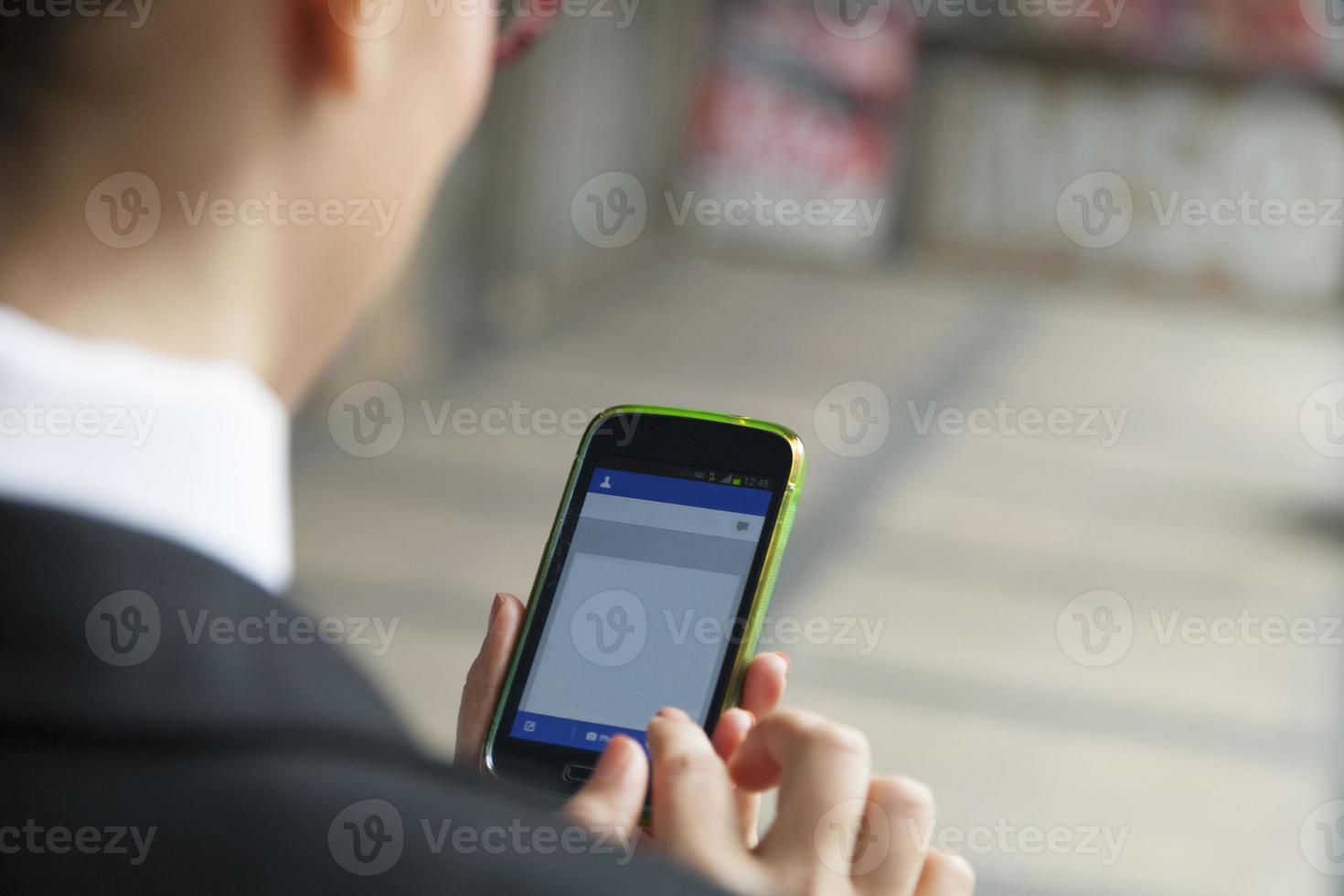usando smart phone-xxl foto