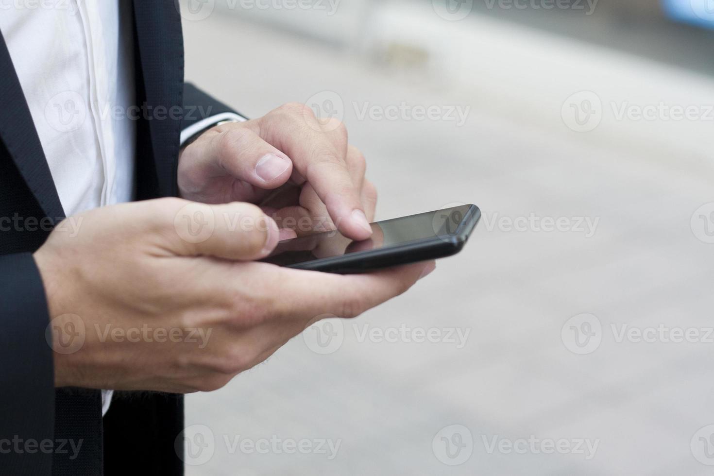 usando telefone inteligente foto