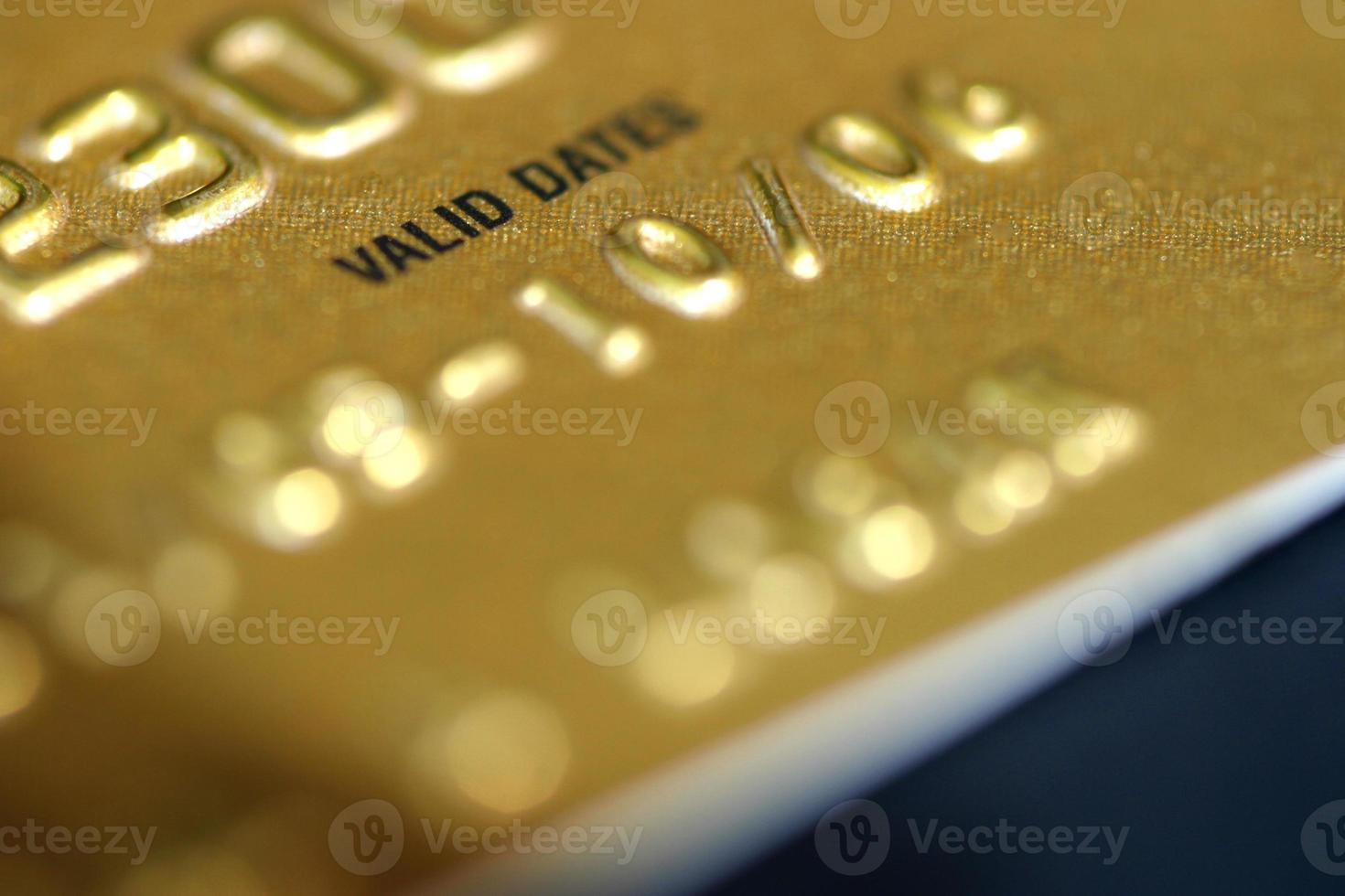 cartão de crédito dourado foto