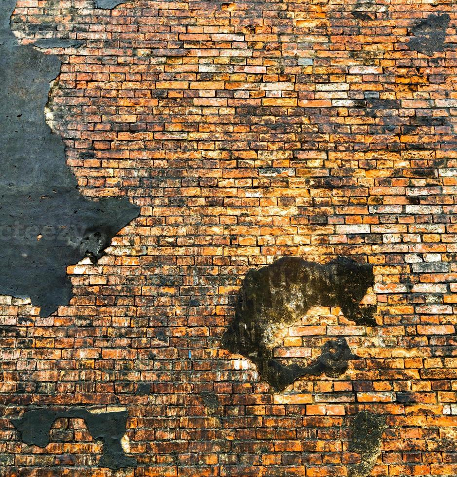 fundo da parede de tijolo laranja foto
