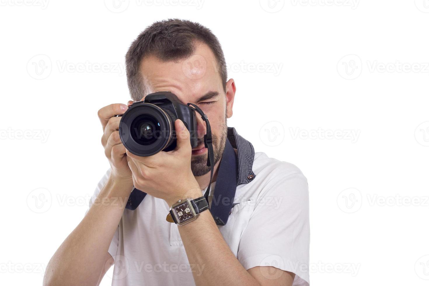 jovem fotógrafo isolado no branco foto