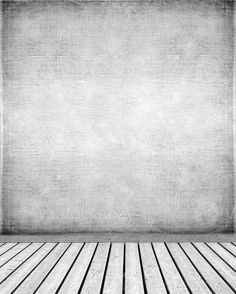 parede de estuque e piso de madeira foto