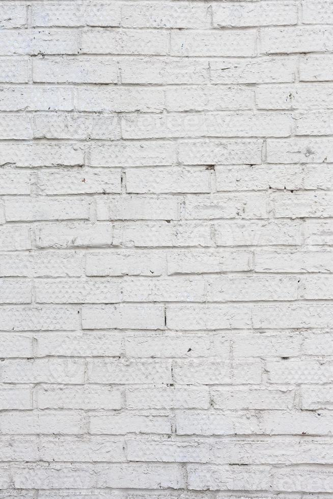 parede de tijolos brancos. parede de concreto branco sujo foto