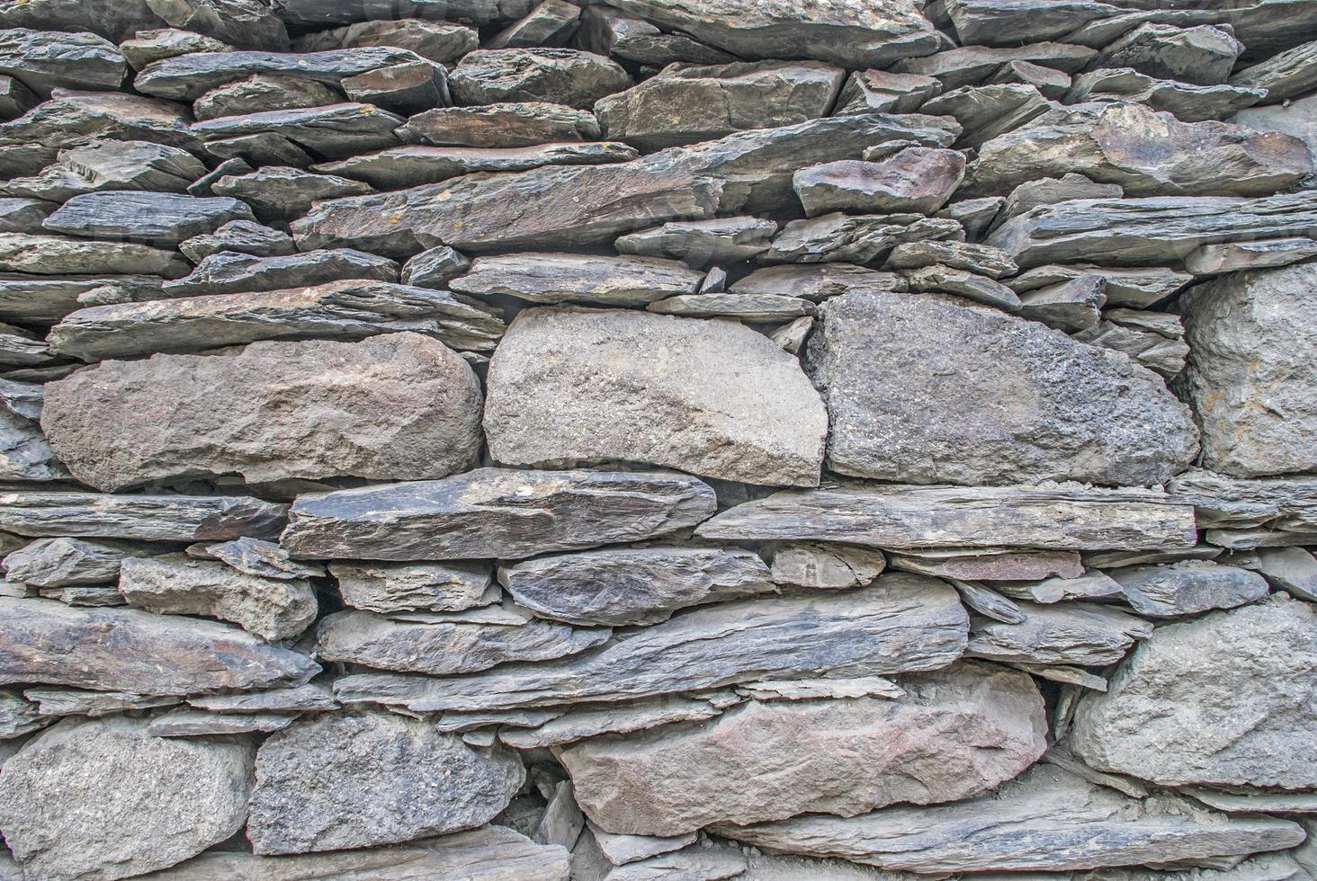 fundo. parede montada com pedras foto