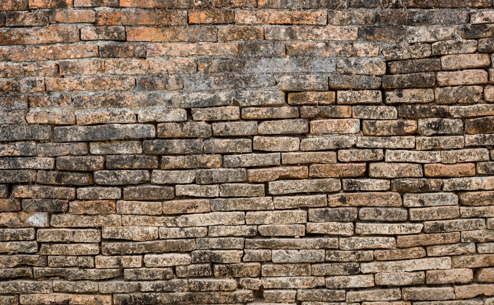 fundo de parede de tijolo velho foto