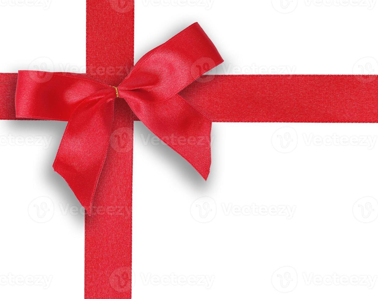 fita vermelha e arco em fundo branco isolado foto