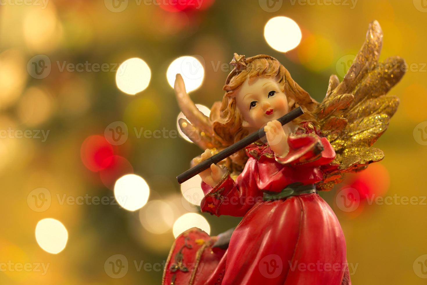 anjo com flauta foto