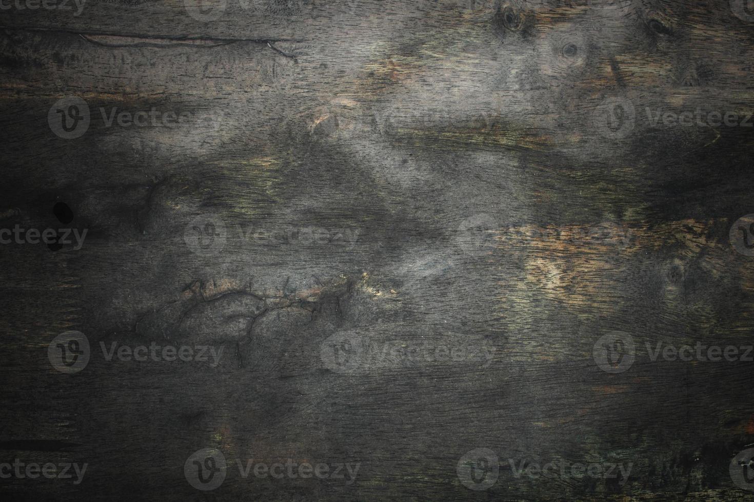 madeira velha escura e fundo de parede de textura grunge foto