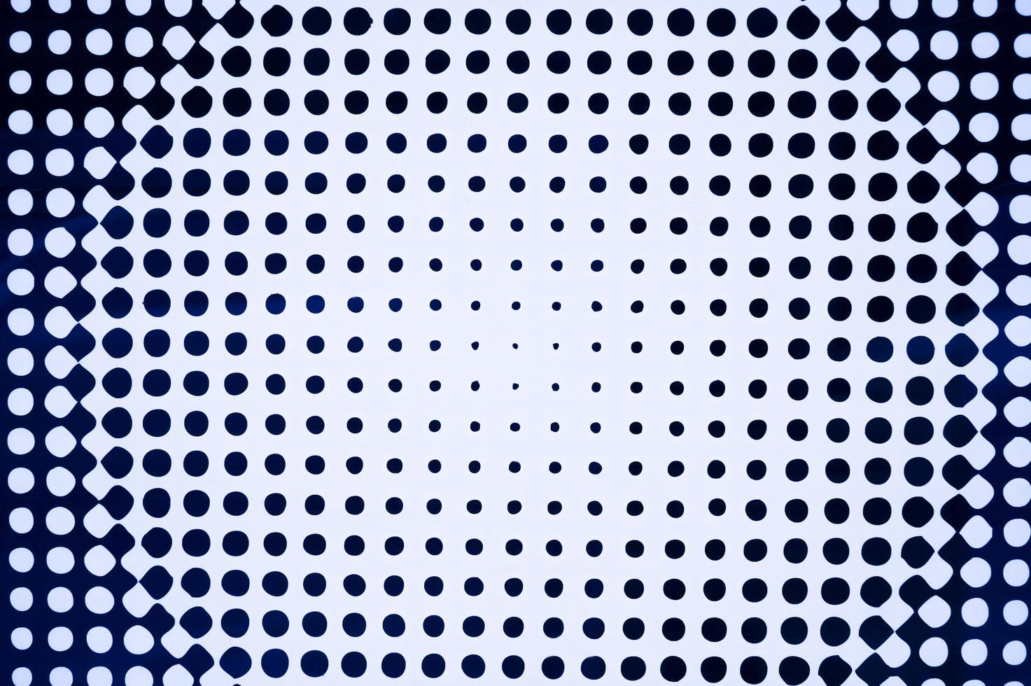 a textura de um fundo branco com círculos pretos de diferentes tamanhos foto