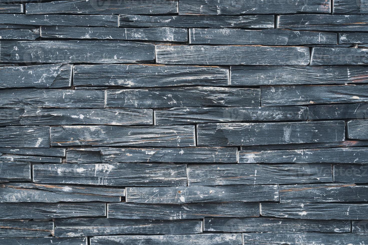 parede de pedra preta envelhecida foto