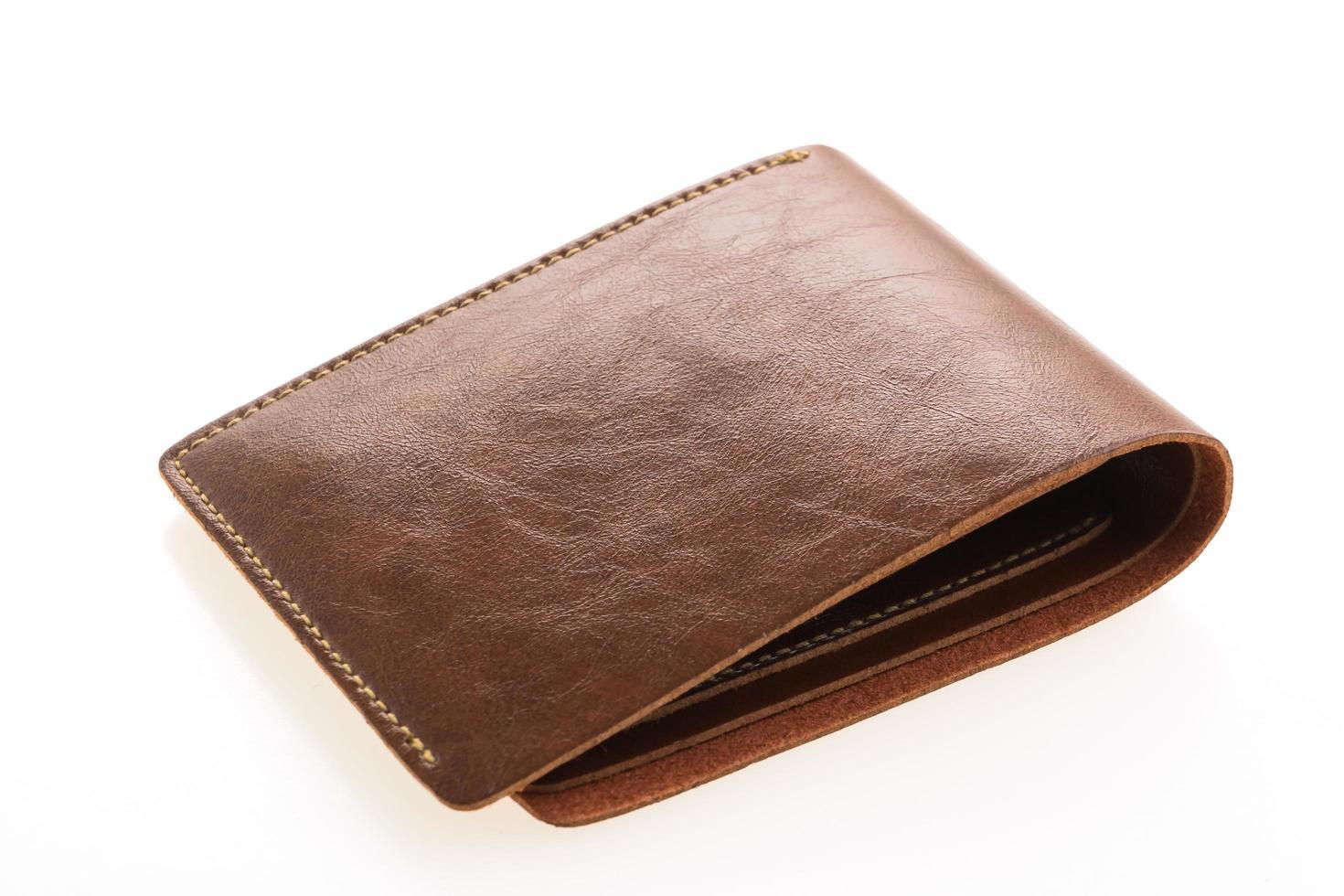 carteira de couro marrom em fundo branco foto