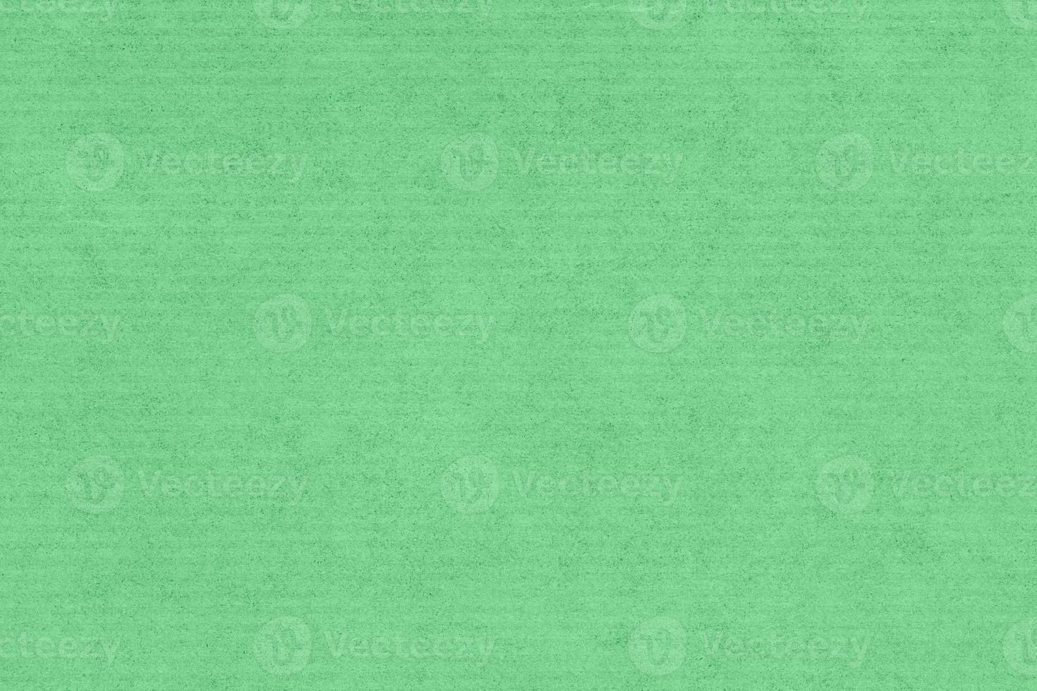 fundo de textura de papel kraft. cor verde foto