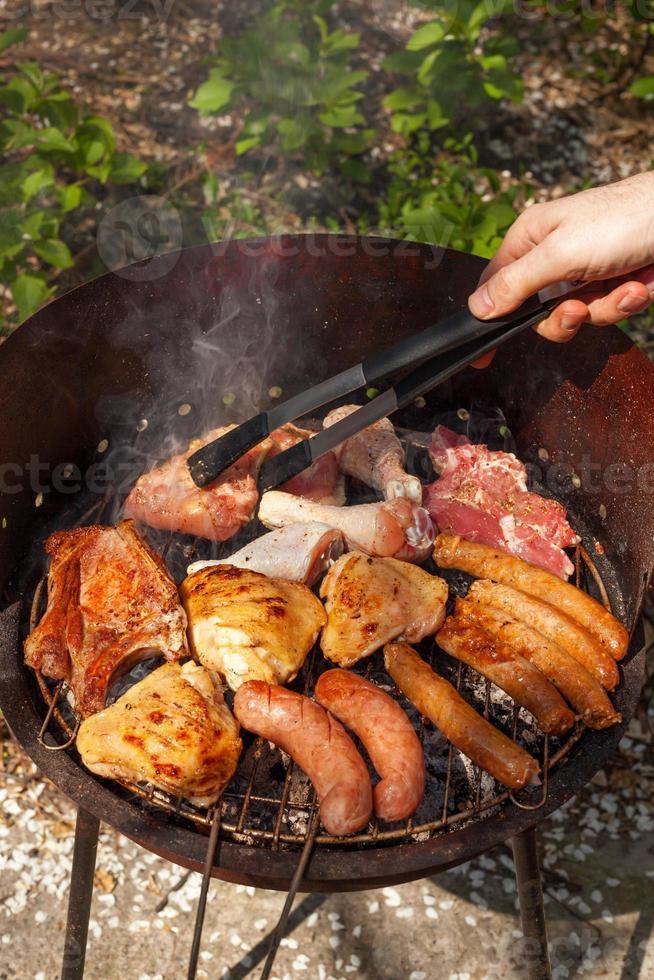 carne no churrasco foto