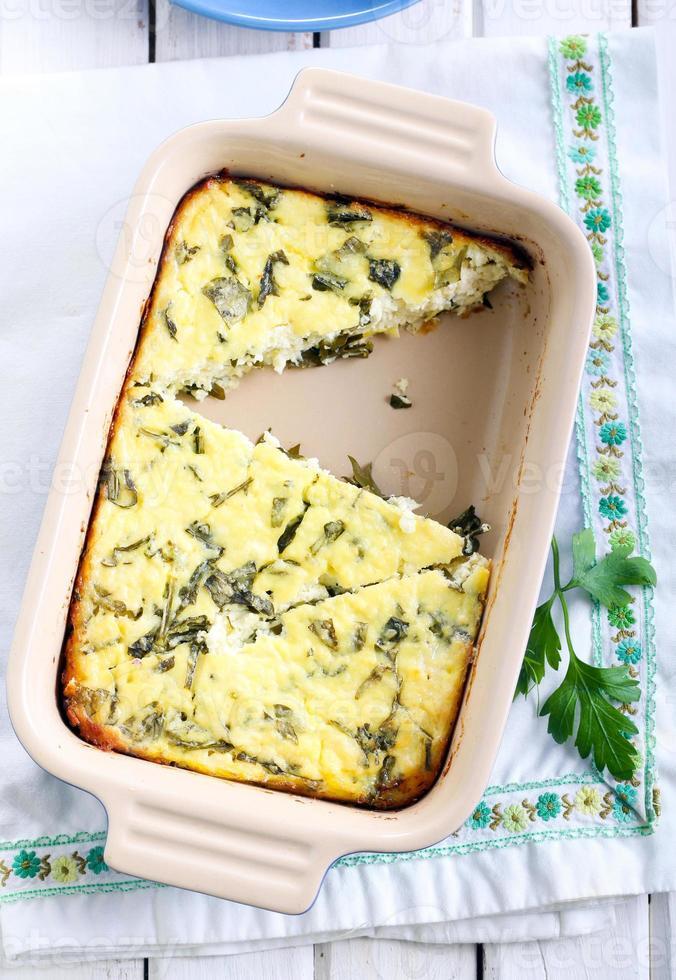 gratinado de queijo e rúcula foto