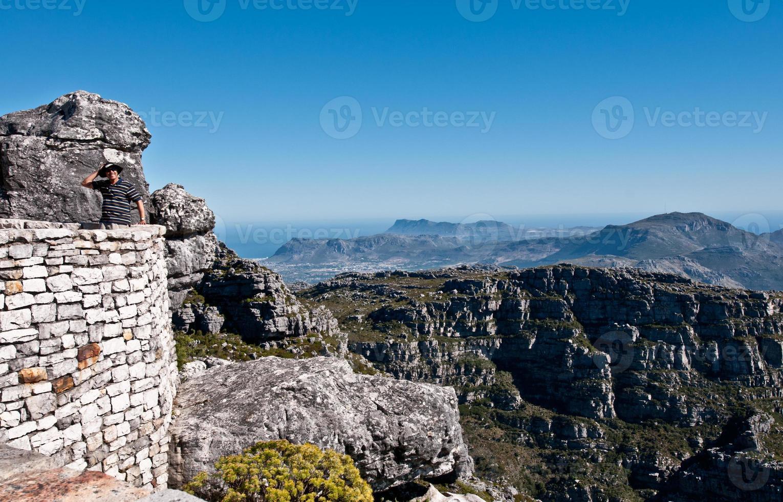 turista no topo da montanha da mesa foto