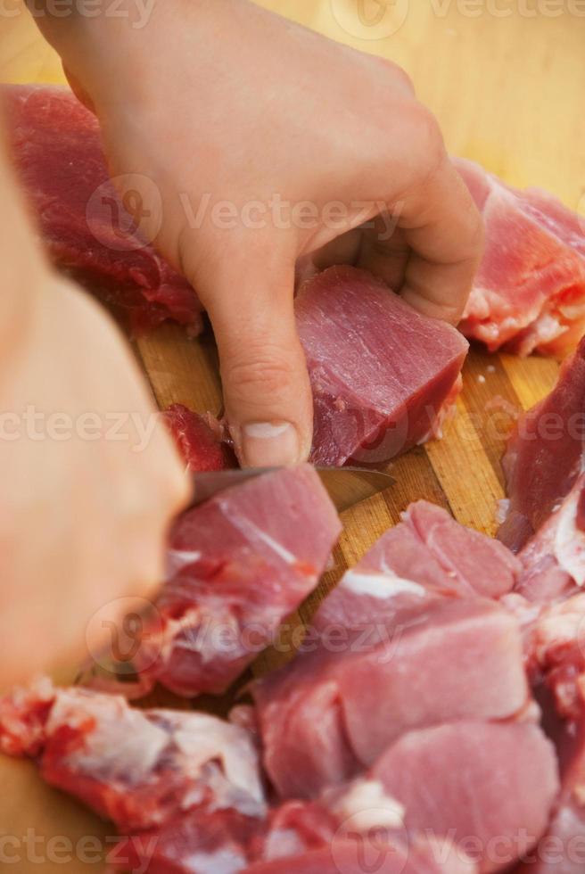 chef cortar carne foto
