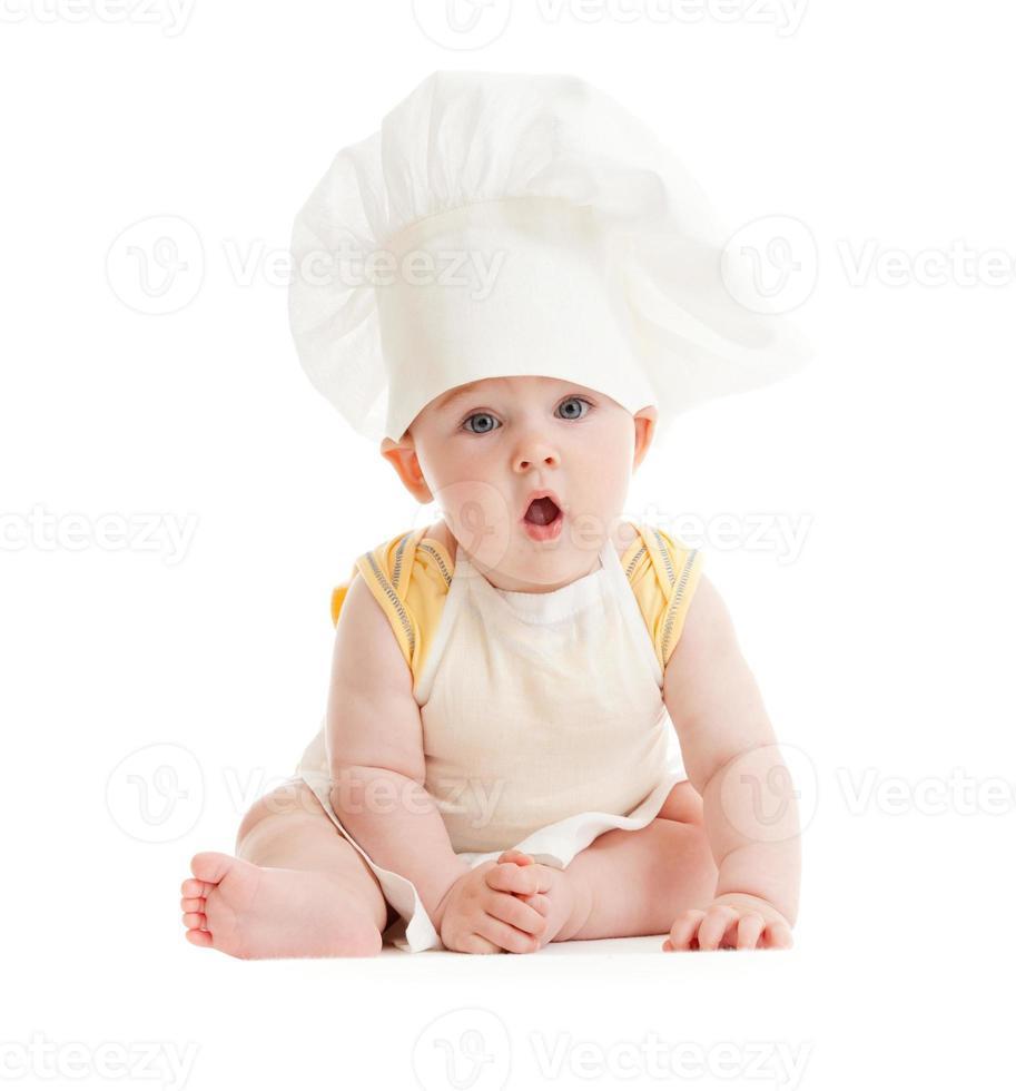 menino surpreso com chapéu de cozinheiro isolado foto