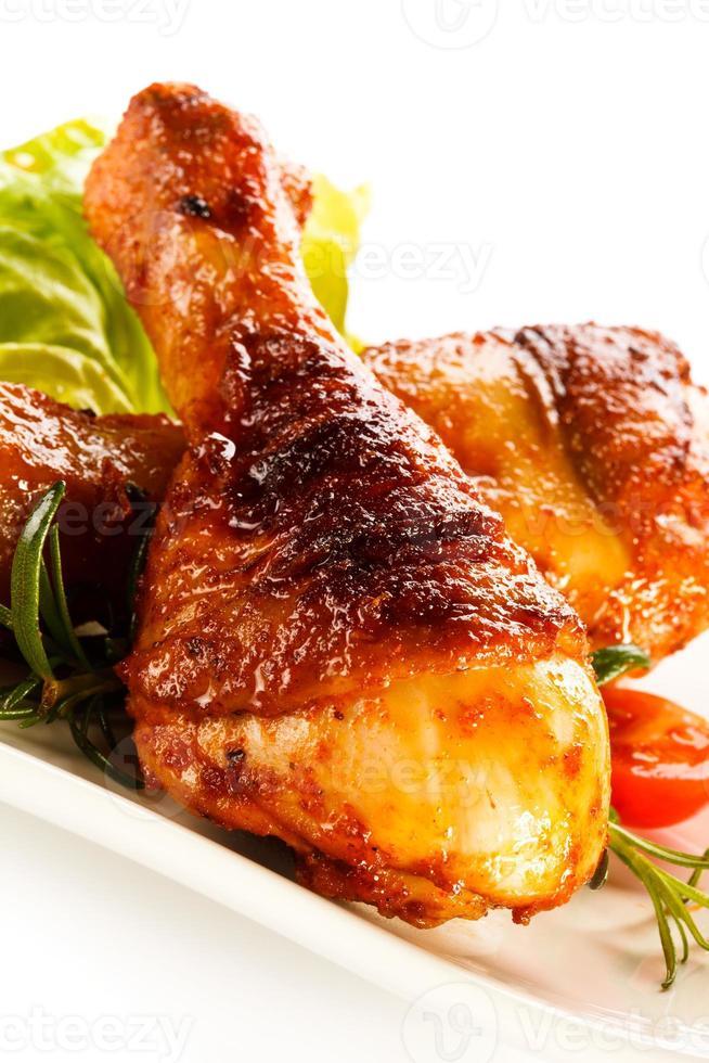 pernas de frango assado foto