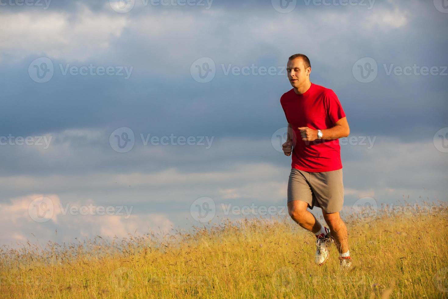 executando o homem de fitness foto