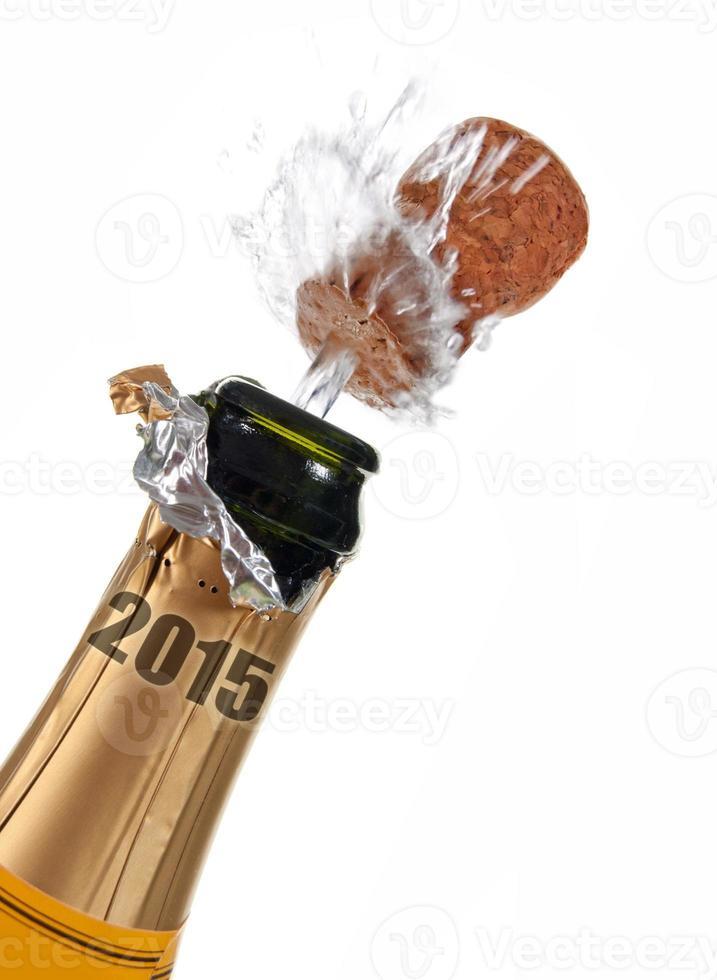 garrafa de champanhe de véspera de ano novo 2015 foto
