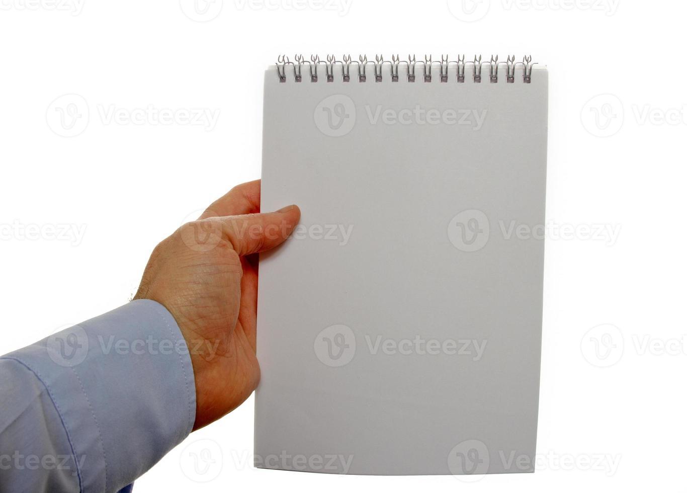 segurando o caderno de lista de verificação foto