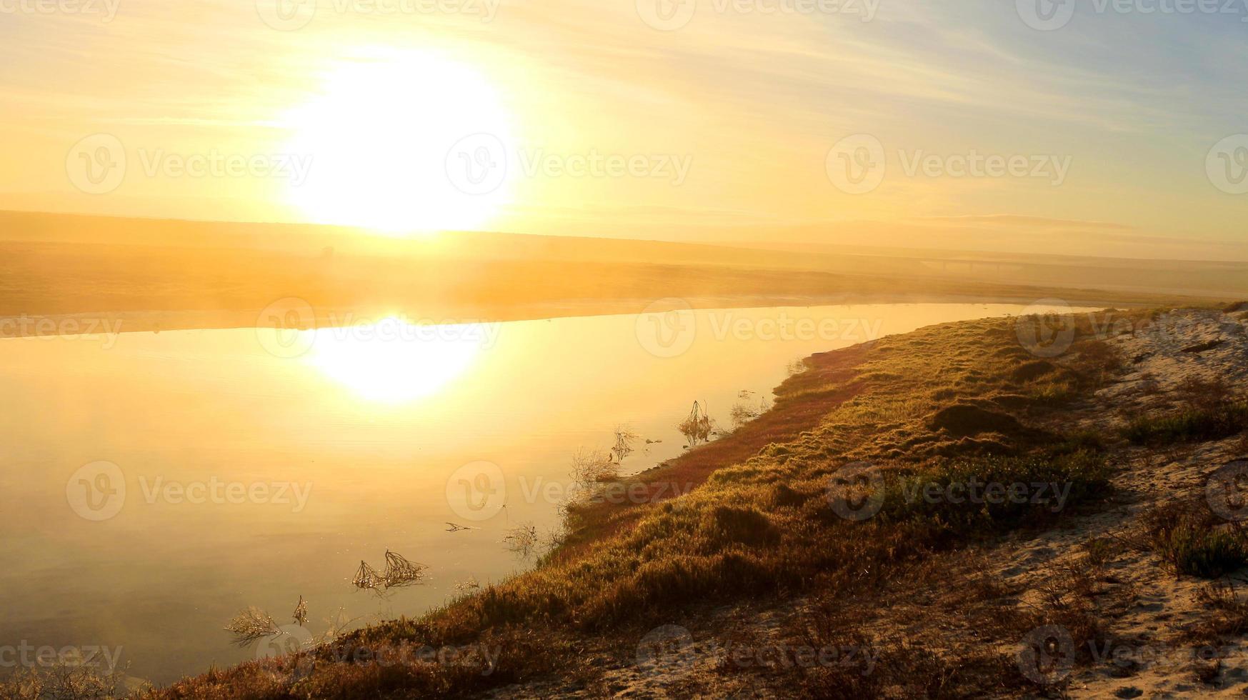 nascer do sol sobre o rio jakkals da baía de lambert foto