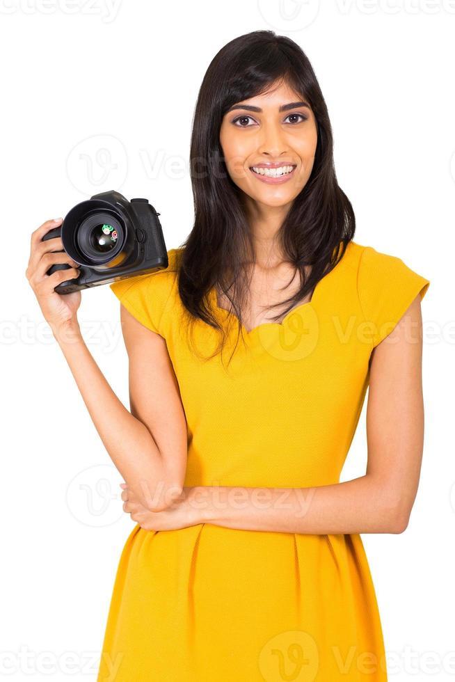 fotógrafo feminino segurando uma câmera foto