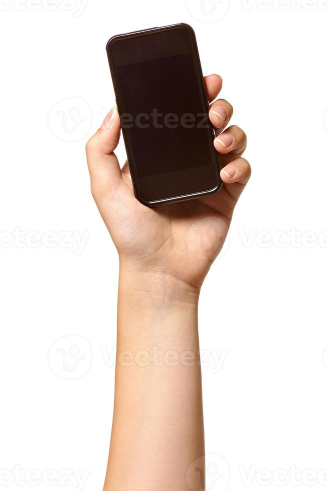 mão segurando o telefone celular foto