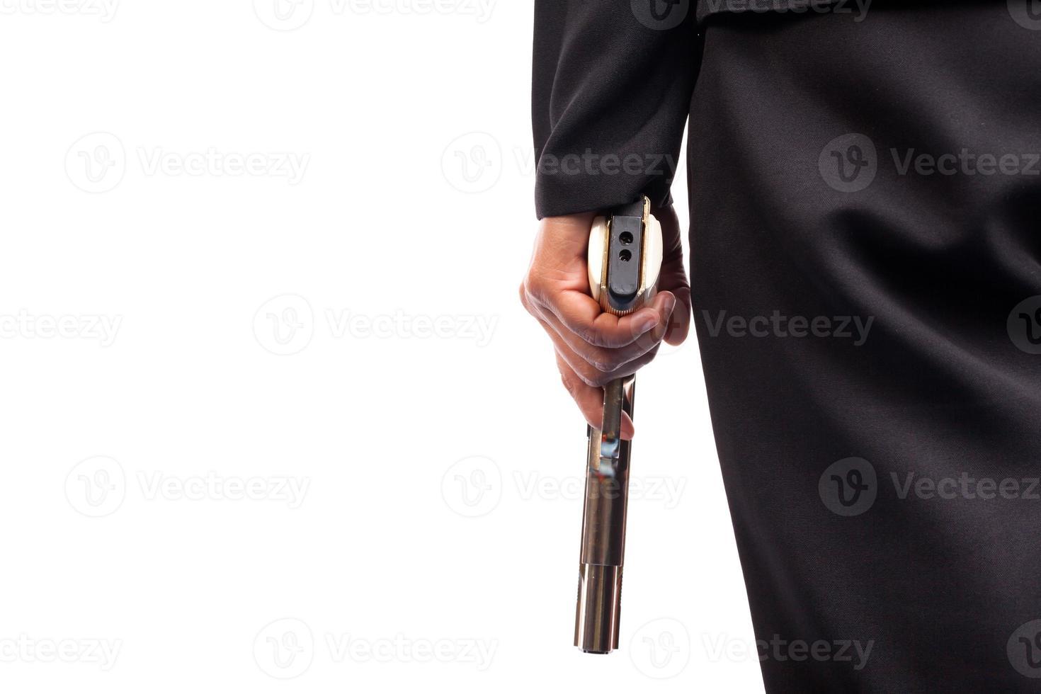 close-up da mulher em um terno de negócio segurando uma arma foto