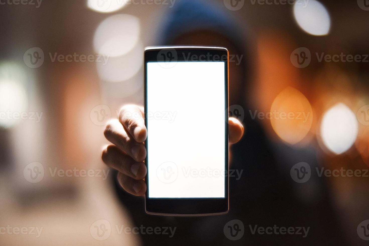 mão com smartphone moderno foto