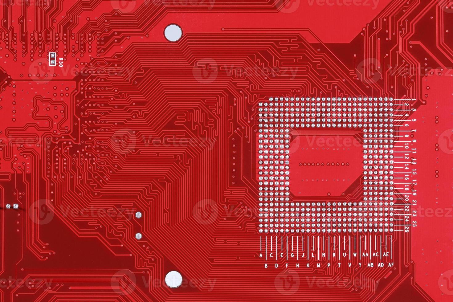 fundo de textura de placa de circuito vermelho da placa-mãe do computador foto