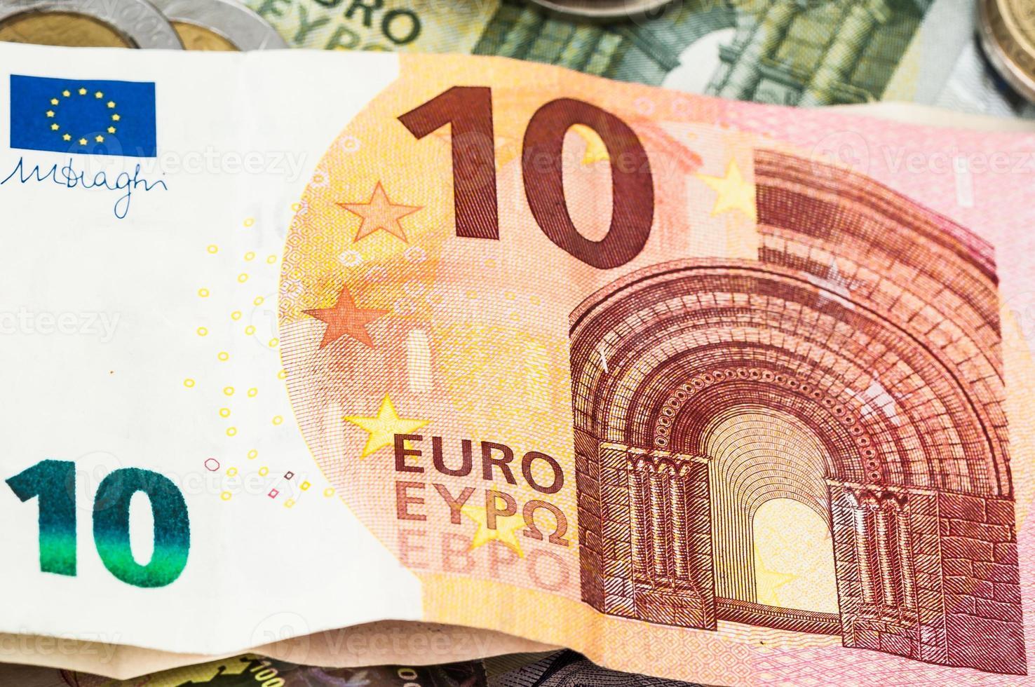 dinheiro dez euro notas de dólar moedas foto