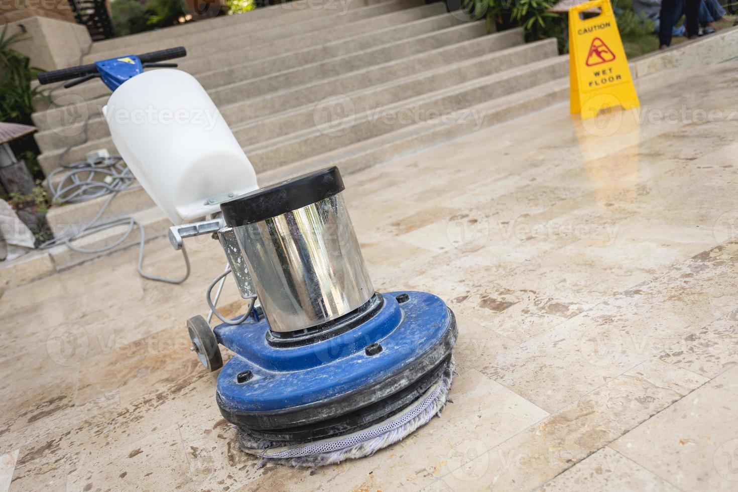close-up azul máquina de polir no chão foto