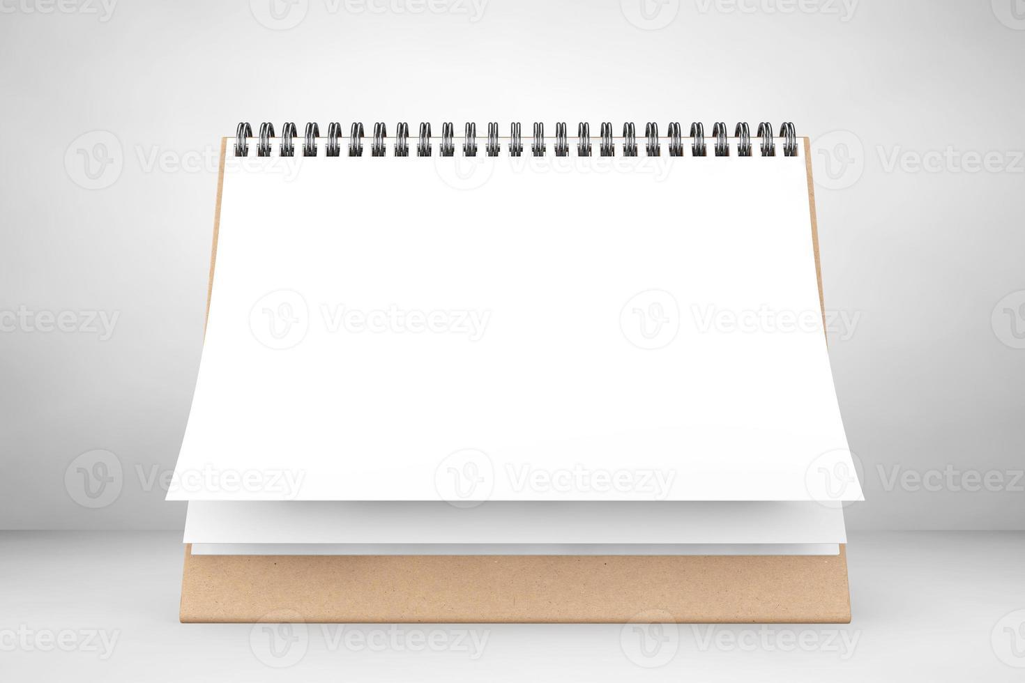 calendário espiral de mesa de papel em branco foto