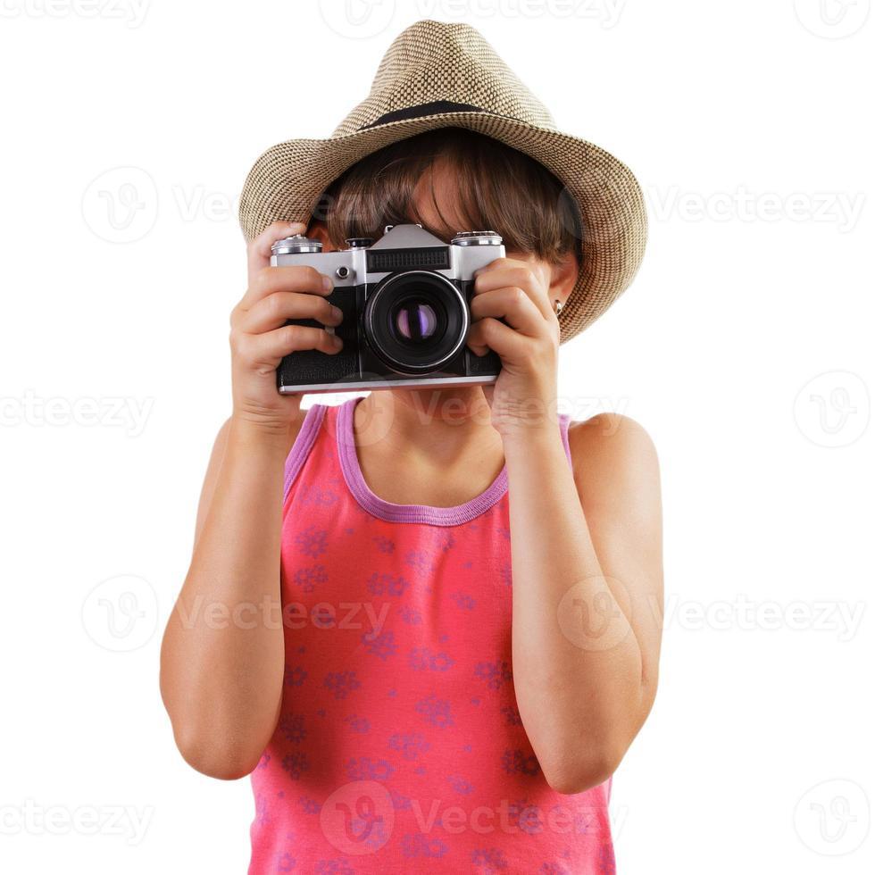 garota com uma câmera de filme nas mãos de foto