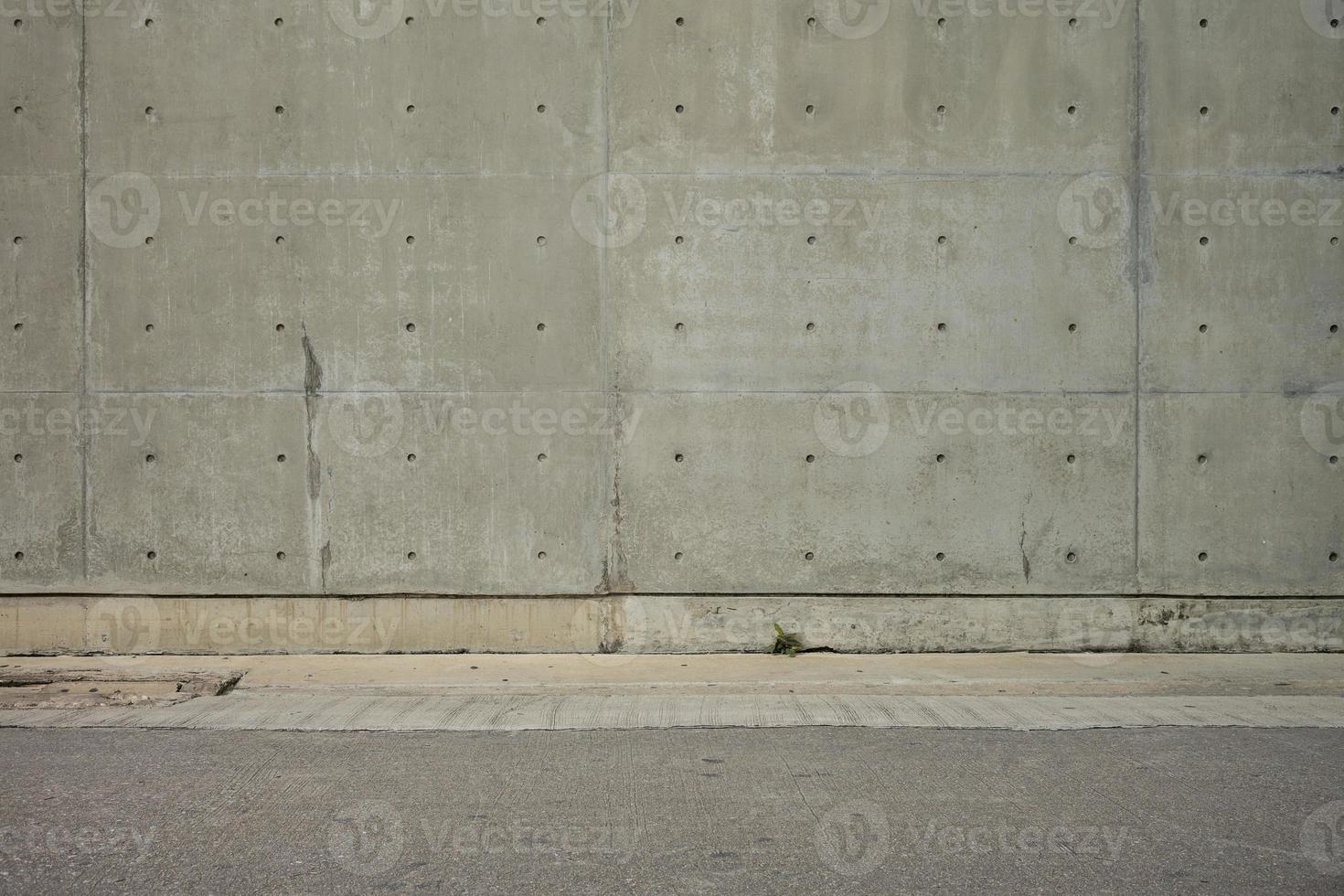 parede de concreto e piso de cimento para espaço de cópia foto