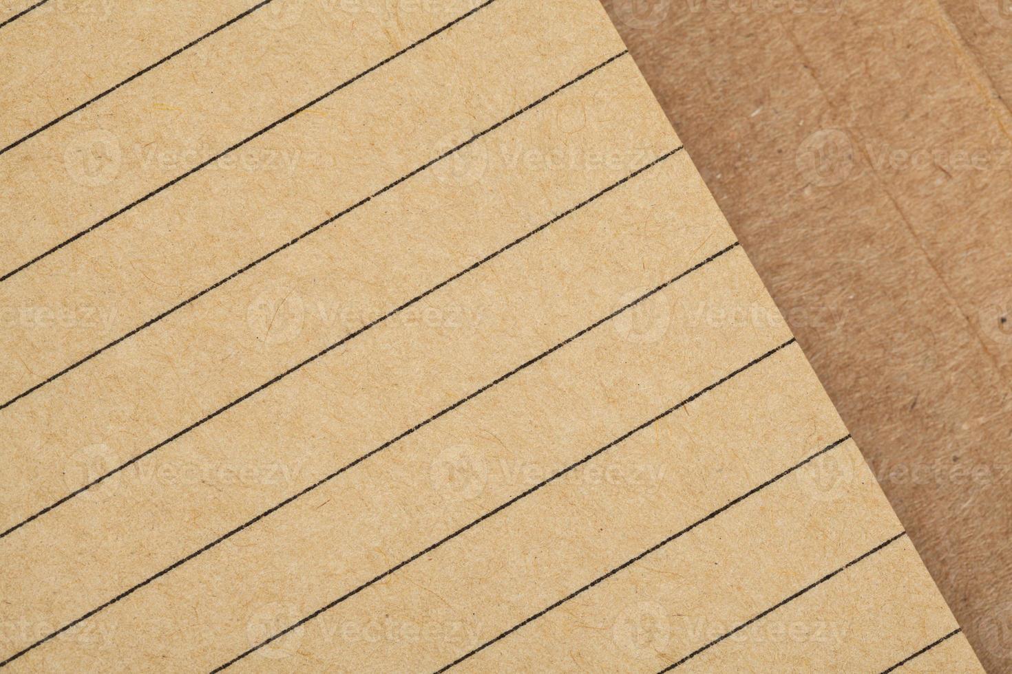 folha de caderno feita de papel reciclado como plano de fundo foto