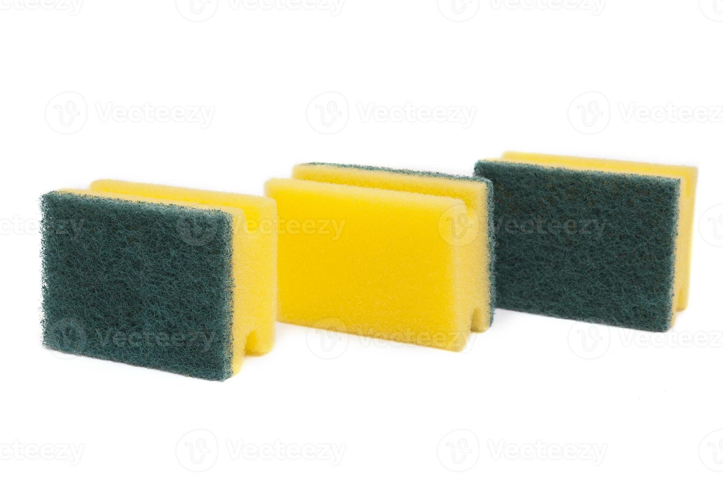 três esponjas de lavar louça foto