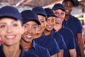 grupo de equipe de trabalhadores têxteis foto