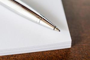caneta e papel foto