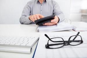 finanças calculadoras de empresário foto