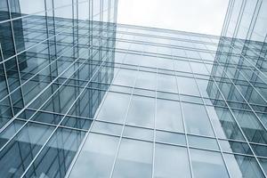 parede de vidro azul moderna dos arranha-céus