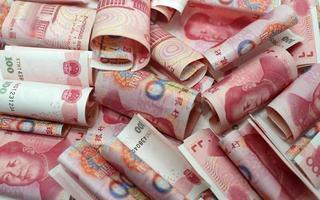 bagunça yuan chinês dinheiro 100 rmb fundo foto