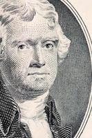 o rosto de jefferson a macro de notas de dólar foto