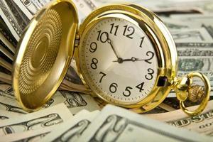 dólares e horas foto