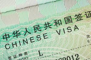 visto de carimbo de passaporte para o fundo do conceito de viagem, chinês foto