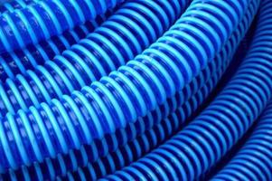 fundo de mangueira plástica azul foto