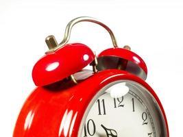 um velho despertador vermelho velho foto