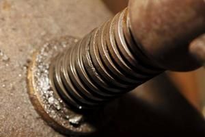close-up detalhe máquina de ferro, fundo industrial foto
